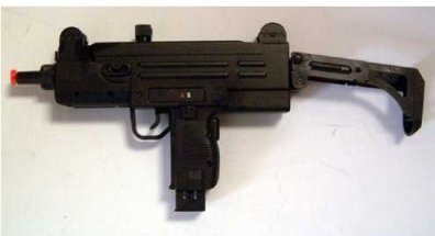 Picture of an Airsoft Uzi gun all black mini, with an orange tip