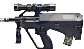 photo of black mini airsoft electric gun