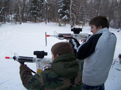 Two of my boys shooting off a few rounds from the deck