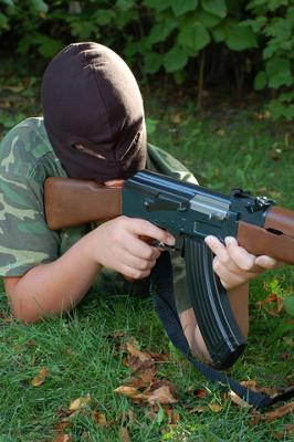 Picture of Airsoft player in woods nearby his home