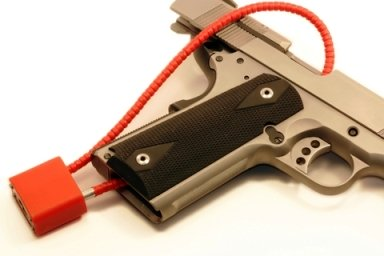 Picture of an Airsoft gun with a safety lock on it.