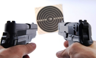 Picture of two guns black in color, handguns shooting at a target. Which is a bb gun and which is an Airsoft gun?